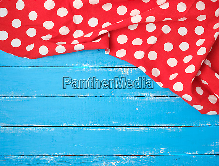 red textile towel with white circles