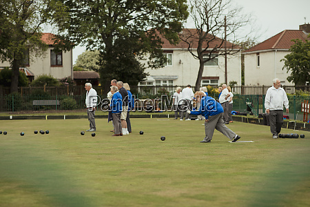 seniors playing lawn bowling