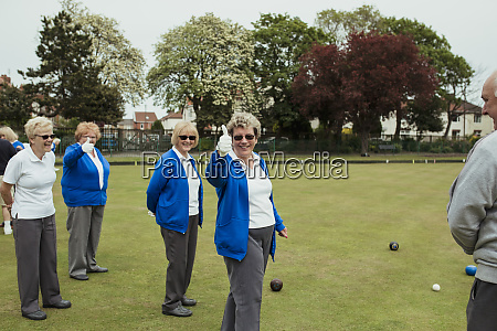 senior women giving the thumbs up
