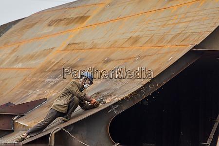china chongqing workman uses grinder on
