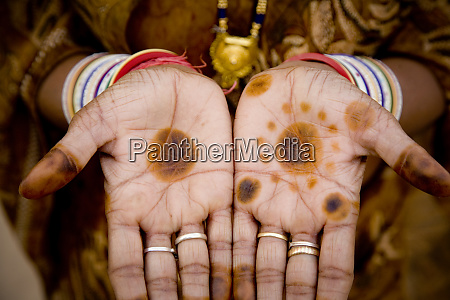 india rajasthan womans hands with henna