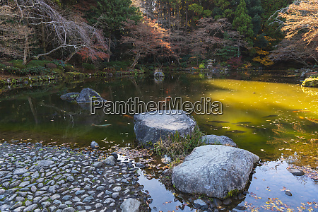 rock path in the lake filled