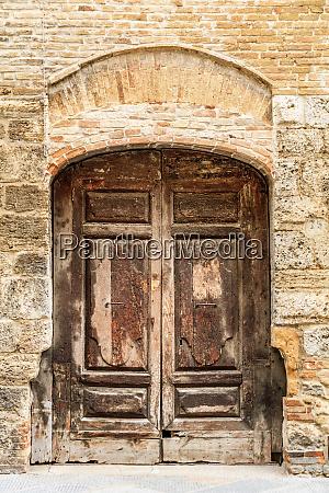italy san gimignano wooden door