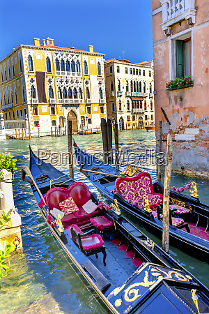 colorful gondolas grand canal buildings and