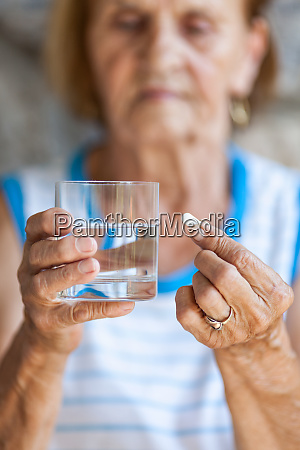 senior woman taking her daily medication