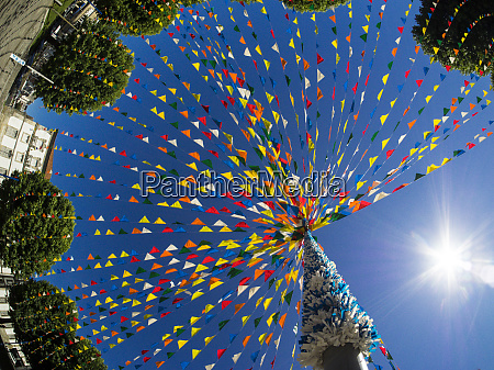 multicolored streamer decorations hanging from pole