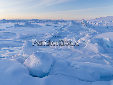 ilulissat at the frozen shore of