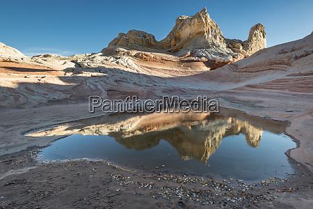 pool reflection and sandstone landscape vermillion