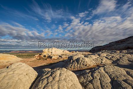 clouds and textured sandstone landscape vermillion