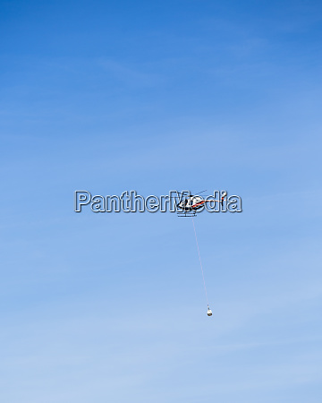 helicopter transporting firefighting equipment over death