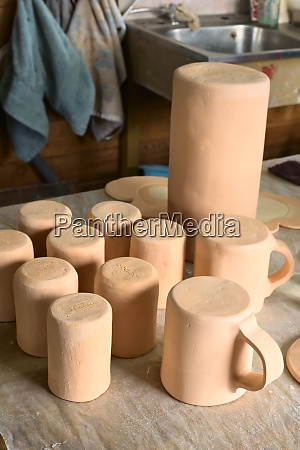 handmade clay pottery in a workshop