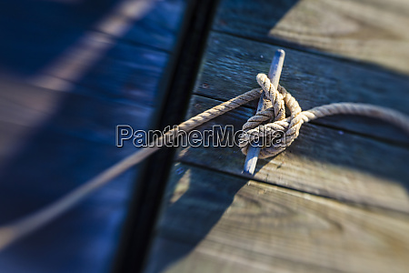 rope tied to a dock in