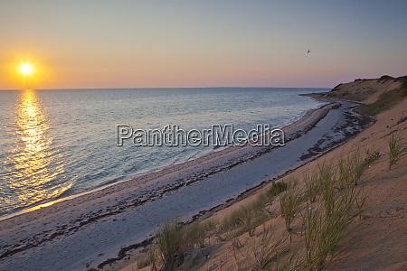 sunset over duck harbor beach in