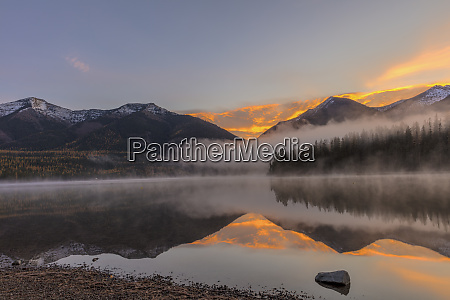 sunrise fog on holland lake in