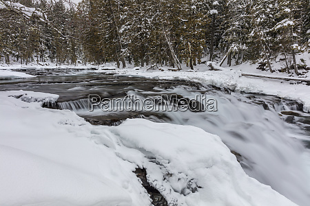 winter along mcdonald falls in glacier