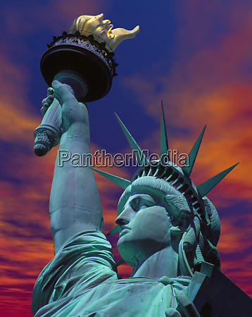 sunset with the statue of liberty