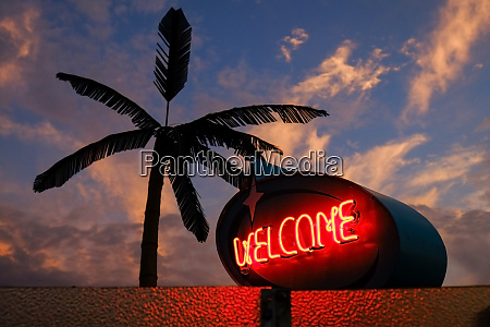 neon welcome sign at sunset wildwood
