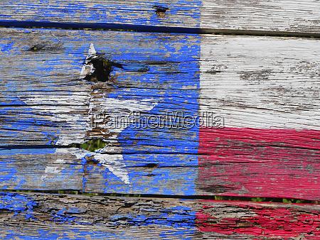 texas flag painted on old wood