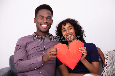romantic couple holding a red heart