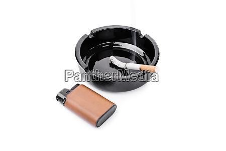 ashtray lighter and a cigarette
