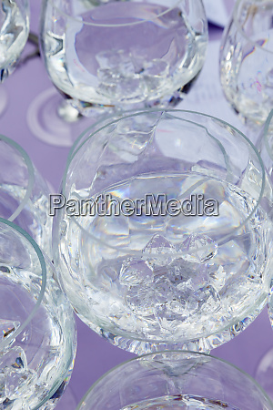 many wine glasses stacked up and