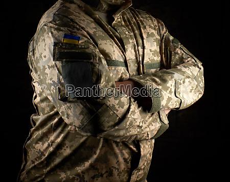 ukrainian soldier in camouflage uniform stands
