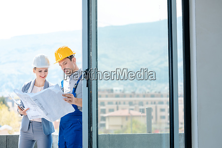 principal and builder reading blueprints on