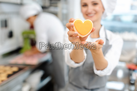 pastry chef baking heart shaped cookies