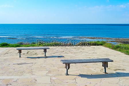 empty benches sea paphos cyprus