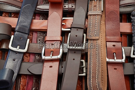 leather belts at a market