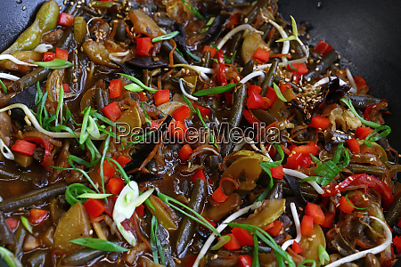 asian stir fried vegetables in wok