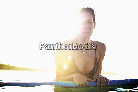 portrait confident female surfer leaning on