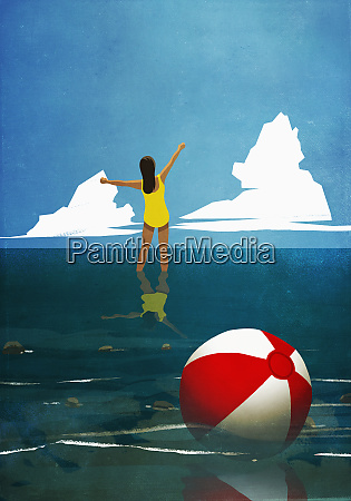 carefree woman wading in summer ocean