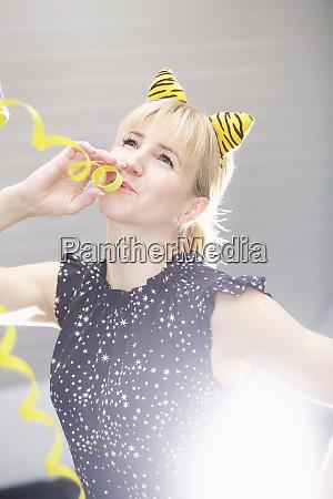 portrait playful woman wearing cat costume