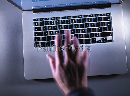cyber crime moving blurred hand typing