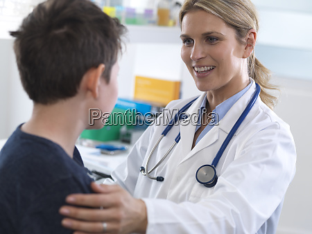 female doctor giving a boy some