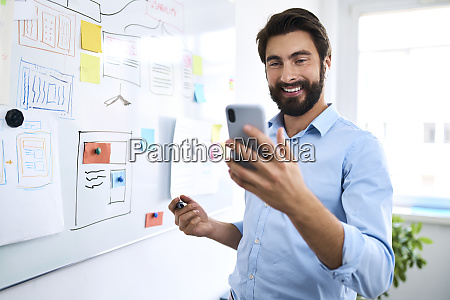 businessman standing in front of a