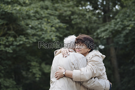 portrait of senior woman hugging her