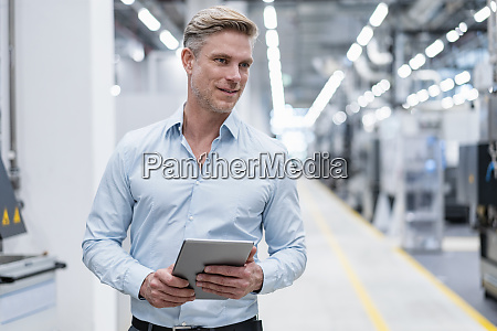 businessman with tablet in a modern