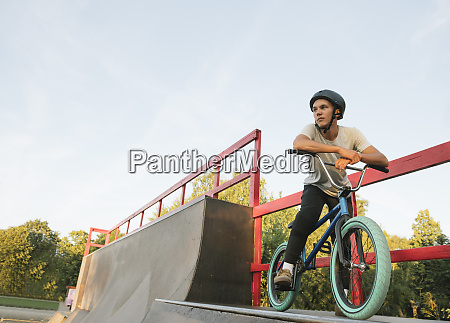 young man with bmx bike at