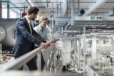 two businessmen talking in a modern