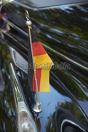 german flag at vintage car adenauer