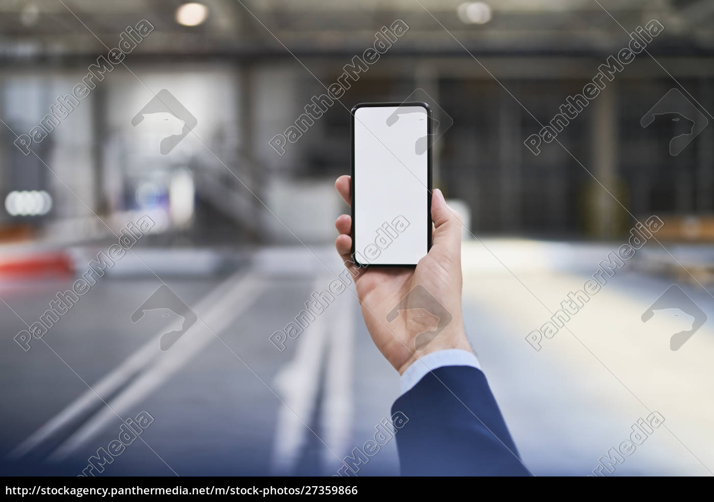 close-up, of, businessman, holding, cell, phone - 27359866