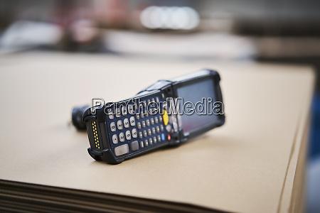 barcode scanner lying on cardbox in