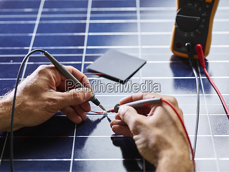 technician measuring resistor of silicon solar