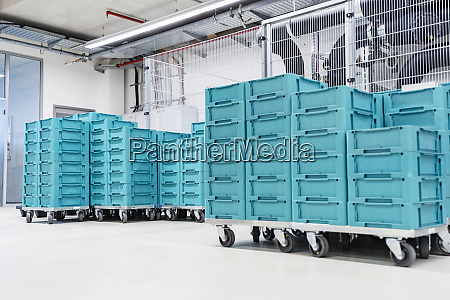 turquoise colored containers inside modern factory