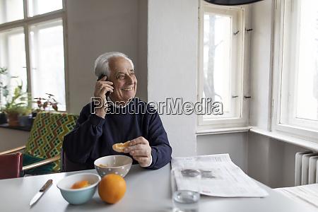smiling senior man on cell phone