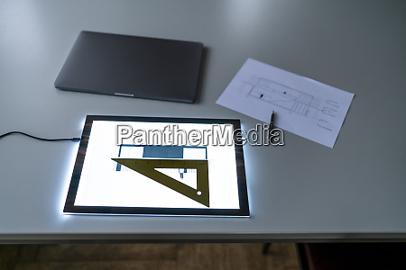 architectural plan on tablet screen on