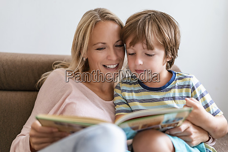 mother and son reading a book