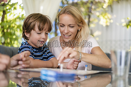 mother and son playing a board
